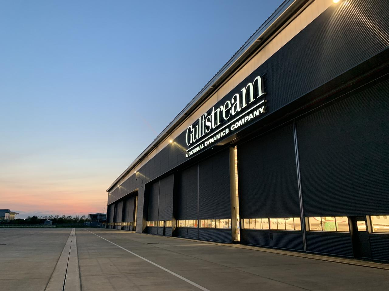 Gulfstream Aerospace at Farnborough Airport – 3 sets of Esavian Type 126 Power operated steel sliding doors – each set of doors is in four equal leaves –2020